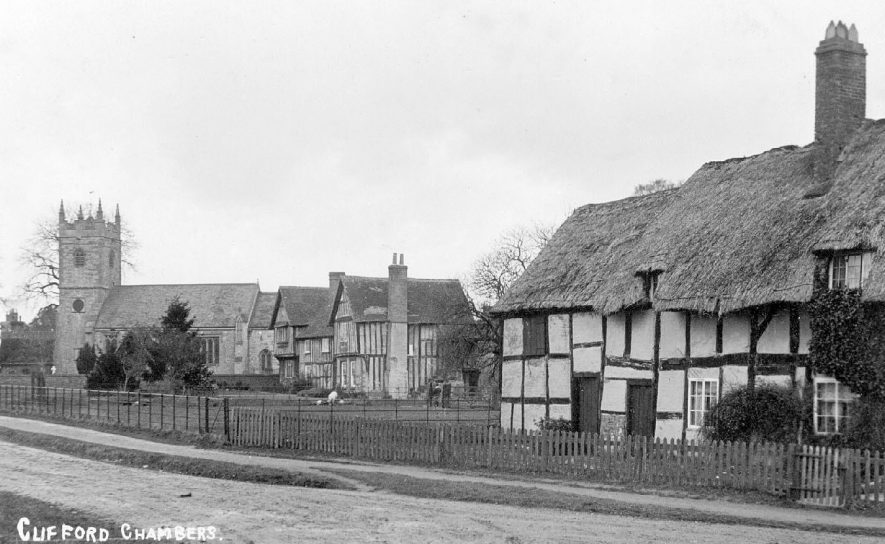 Village street in Clifford Chambers showing church and old thatched, timber framed houses.  1910s |  IMAGE LOCATION: (Warwickshire County Record Office)