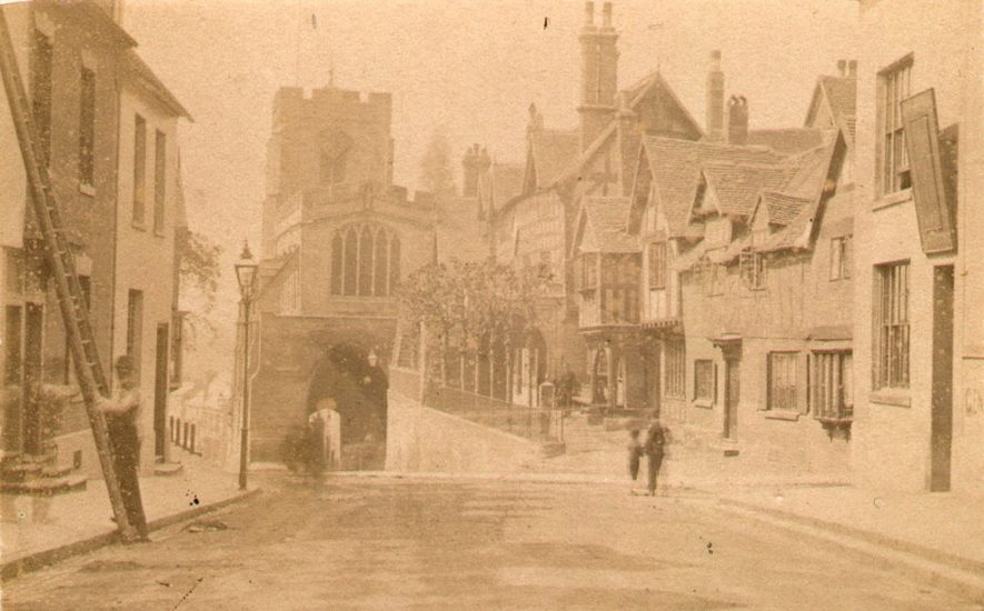 View of Lord Leycester Hospital and the West Gate, Warwick.  c. 1870  Man and a ladder. |  IMAGE LOCATION: (Warwickshire County Record Office) IMAGE DATE: (c.1870)