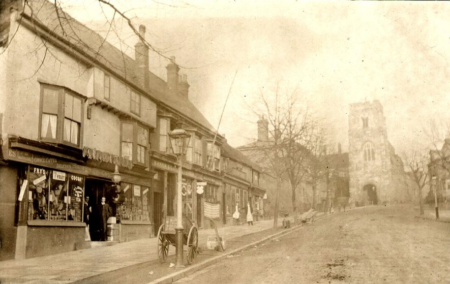 West Street, Warwick, looking towards the West Gate. From a photograph album in the Eleanor Archer papers.  1900s |  IMAGE LOCATION: (Warwickshire County Record Office)