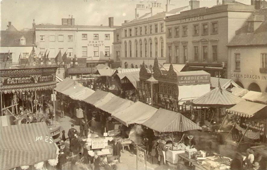 Mop fair in Warwick Market Square.  1900s |  IMAGE LOCATION: (Warwickshire County Record Office)
