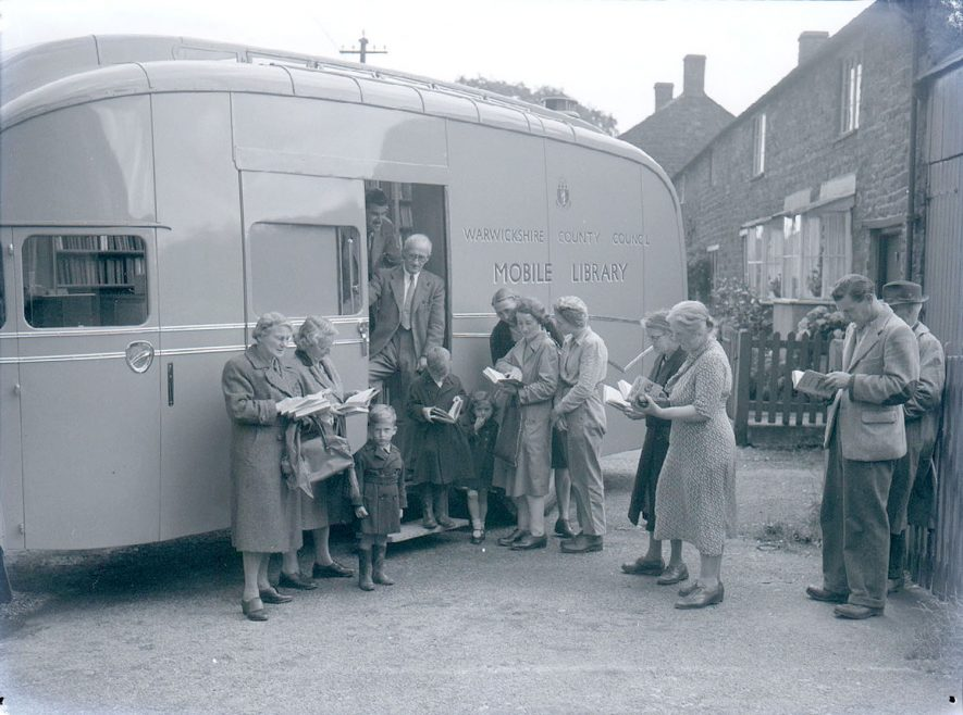 People standing outside the W.C.C mobile library van in Tysoe.  August 2nd 1950 |  IMAGE LOCATION: (Warwickshire County Record Office)