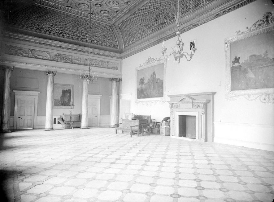 Interior of Compton Verney entrance hall, showing the fireplace and paintings.  October 29th 1957 |  IMAGE LOCATION: (Warwickshire County Record Office)