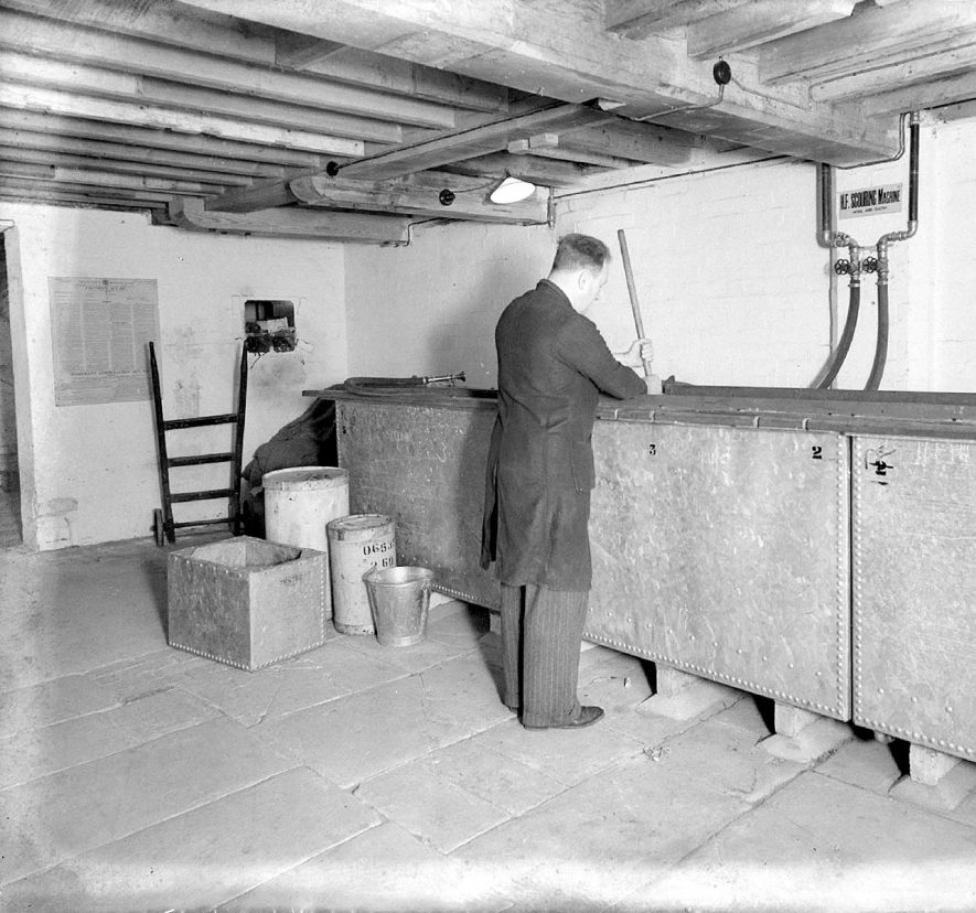 Clifford Chambers mill interior showing a worker at the scouring machine. May 6th 1939 |  IMAGE LOCATION: (Warwickshire County Record Office)