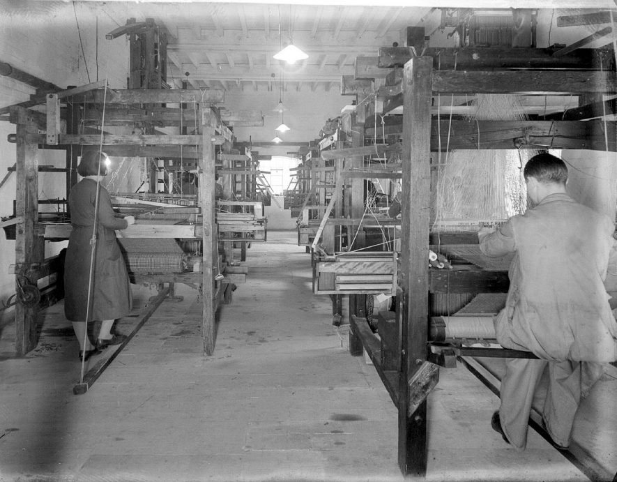 Workers at the weaving looms at Clifford Chambers Mill.  May 6th 1939 |  IMAGE LOCATION: (Warwickshire County Record Office)