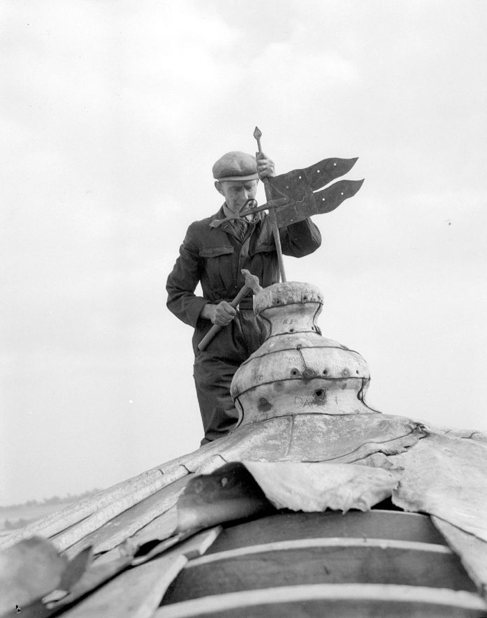 Man repairing the weather vane on Chesterton windmill.  September 13th 1949 |  IMAGE LOCATION: (Warwickshire County Record Office)