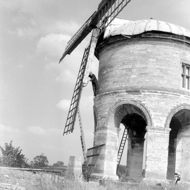 Chesterton.  Repairing the windmill sails
