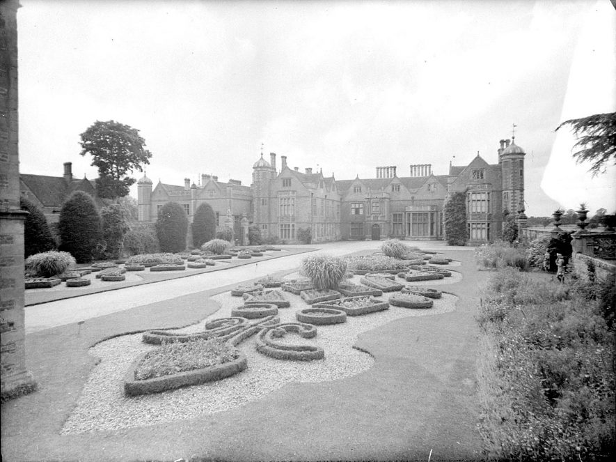Charlecote Park, house east front and gardens.  1950s |  IMAGE LOCATION: (Warwickshire County Record Office)