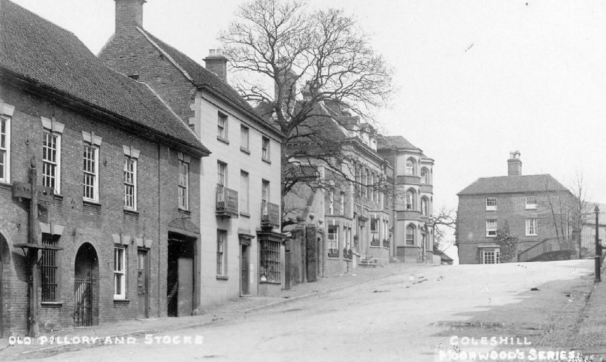 View of Coleshill, showing the old pillory and stocks outside the police station.  1920s |  IMAGE LOCATION: (Warwickshire County Record Office)