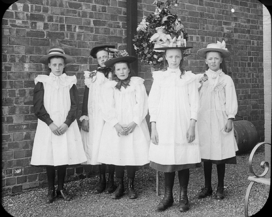 Gertrude Woodward, Gladys Woodward, Elizabeth Salmon and Eva Coldicott dressed up on May Day at Clifford Chambers.  1901 |  IMAGE LOCATION: (Warwickshire County Record Office) PEOPLE IN PHOTO: Woodward, Gladys, Woodward, Gertrude, Woodward as a surname, Salmon, Elizabeth, Salmon as surname, Coldicott, Eva, Coldicott as a surname