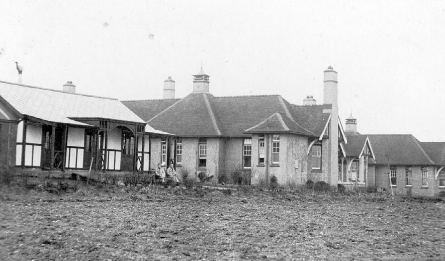 Two patients enjoying the air outside the hospital of St Gerards, at Coleshill.  1917    IMAGE LOCATION: (Warwickshire County Record Office)