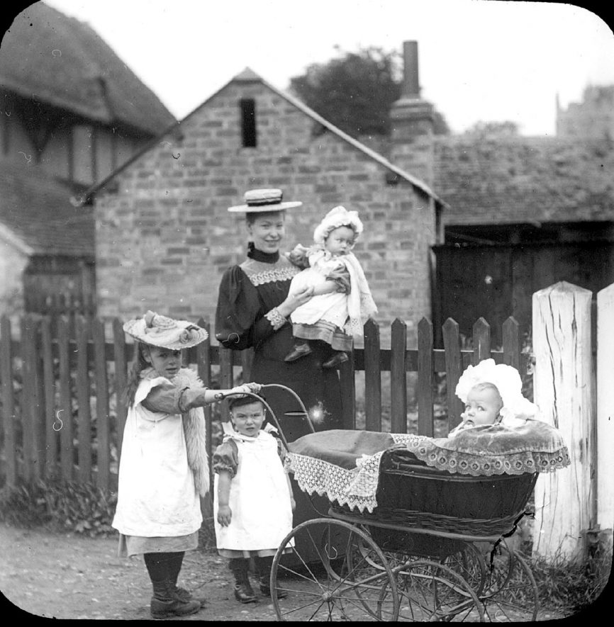 Lady with four children, one in a perambulator. Clifford Chambers.  1900s |  IMAGE LOCATION: (Warwickshire County Record Office)