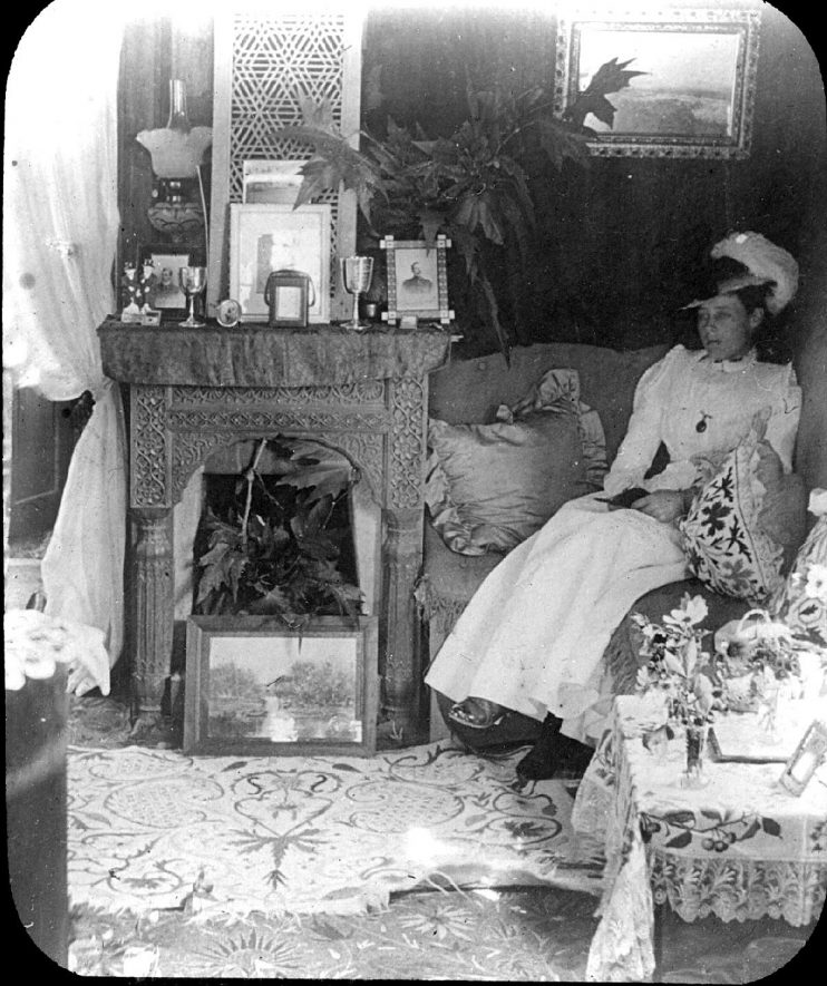 Mrs Briscoe in the sitting room of ? Close Cottage, Clifford Chambers.  1901 |  IMAGE LOCATION: (Warwickshire County Record Office) PEOPLE IN PHOTO: Briscoe, Mrs, Briscoe as a surname