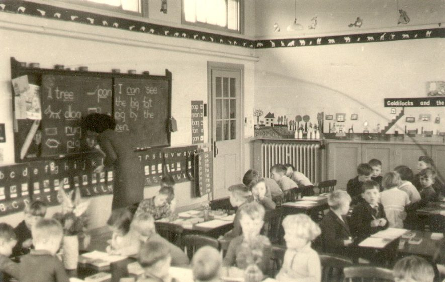 Children working at their desks in school. Place unknown.  1930s |  IMAGE LOCATION: (Warwickshire County Record Office)