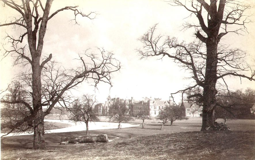 Charlecote Park, house from the south west, with the River Avon in the foreground.  1900s    IMAGE LOCATION: (Warwickshire County Record Office)