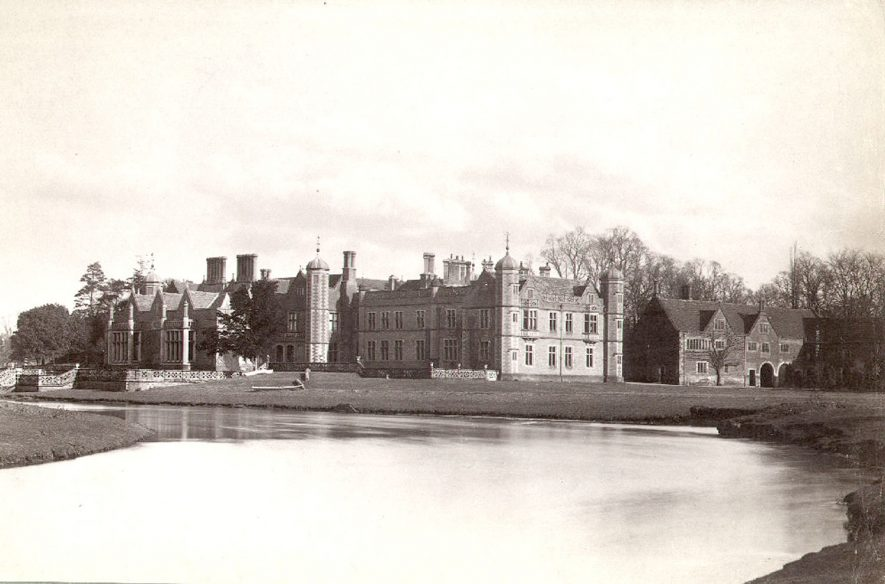 Charlecote Park. House from the south-west, with the River Avon in the foreground.  1900s |  IMAGE LOCATION: (Warwickshire County Record Office)