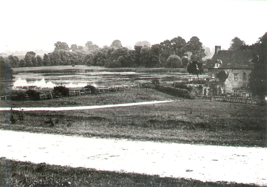 The mill pool, with the mill on the right, Chesterton.  1900s |  IMAGE LOCATION: (Warwickshire County Record Office)