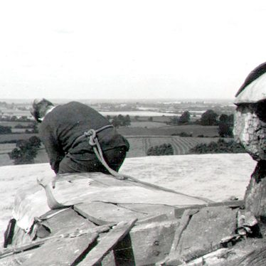 Chesterton.  Man working on windmill roof