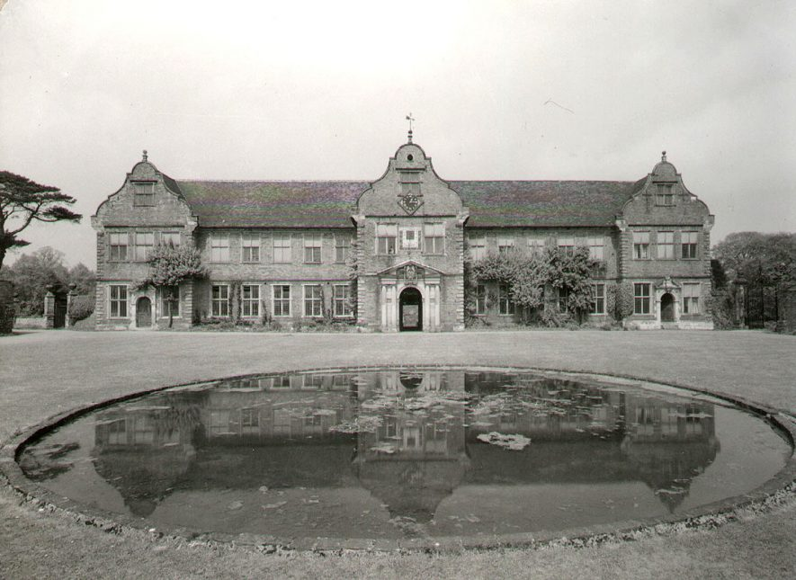 The stables at Arbury Hall, from the south.  1950s |  IMAGE LOCATION: (Warwickshire County Record Office)