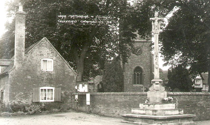 The war memorial and St Helen's church, Clifford Chambers.  1920s |  IMAGE LOCATION: (Warwickshire County Record Office)