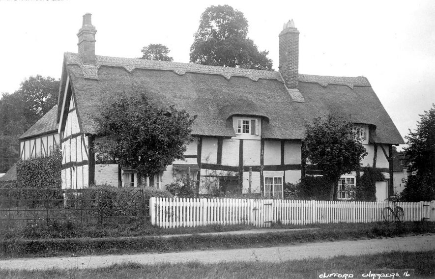 A thatched and timbered house in Clifford Chambers.  1920s |  IMAGE LOCATION: (Warwickshire County Record Office)