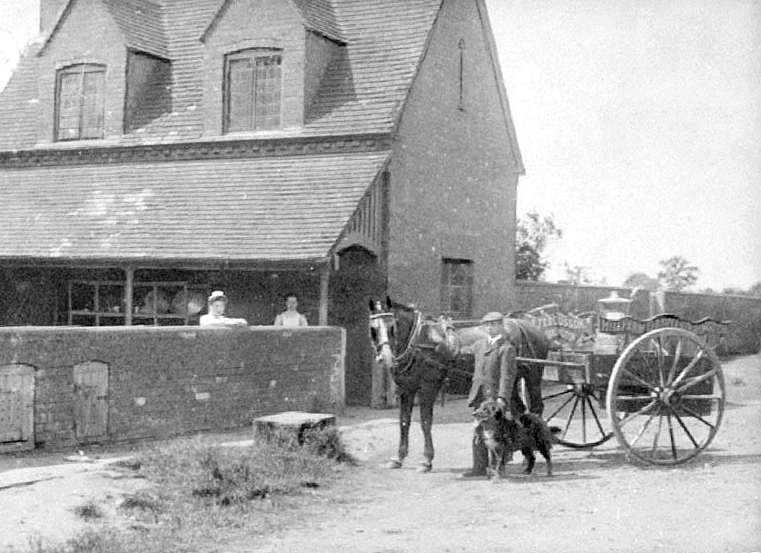 Hill Farm, Cubbington. Man and dog with horse drawn milk cart outside farm building. Two women looking over wall.  1904 |  IMAGE LOCATION: (Warwickshire County Record Office)