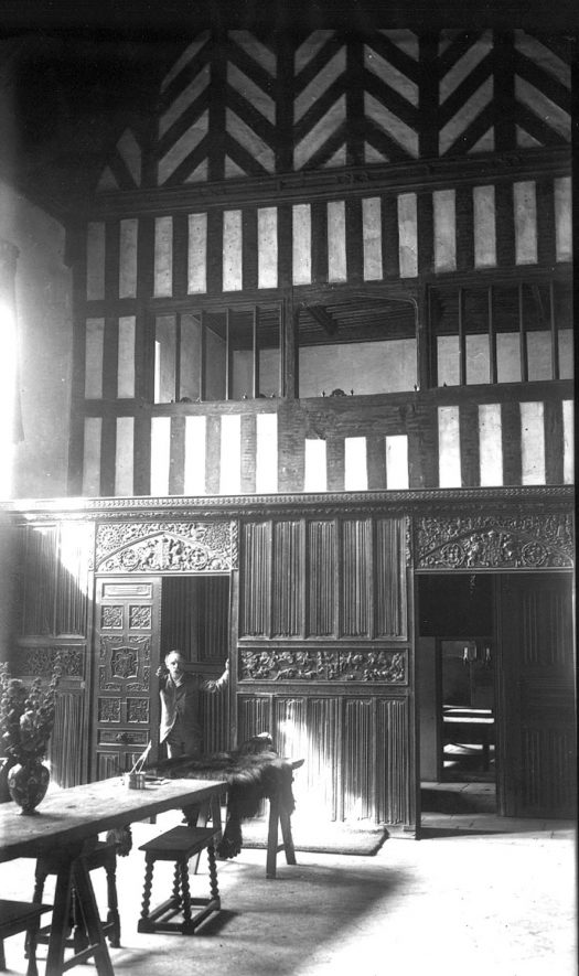 Compton Wynyates house interior, showing some intricately carved panels.  1910s |  IMAGE LOCATION: (Warwickshire County Record Office)