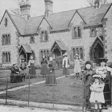 Combrook.  Women and children in front of cottages