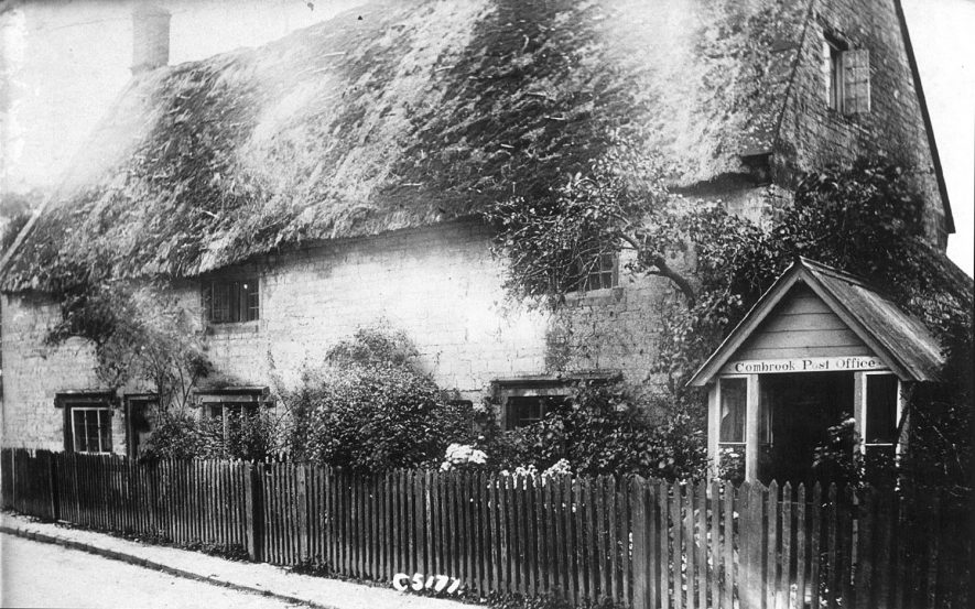 Combrook post office, at the side of a thatched cottage.  1900s |  IMAGE LOCATION: (Warwickshire County Record Office)