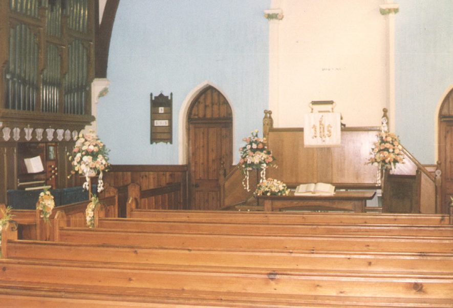 Interior of the chapel at Dunnington, decorated for a wedding.  1990 |  IMAGE LOCATION: (Warwickshire County Record Office)