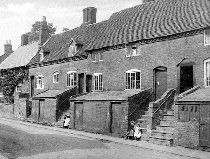 Children sitting on steps of cottages in Ledbrook Road (formerly Jacobs Lane), Cubbington.  1904 |  IMAGE LOCATION: (Warwickshire County Record Office)