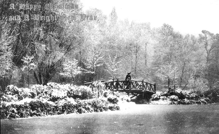 The Mill Gardens and footbridge, Leamington Spa, in the winter snow.  1900s |  IMAGE LOCATION: (Warwickshire County Record Office)