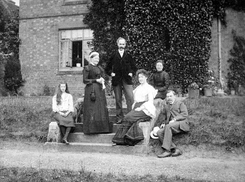 Family group sitting on the steps at Hill Farm, Cubbington. Possibly Robert Ferguson and family.  1904 |  IMAGE LOCATION: (Warwickshire County Record Office)