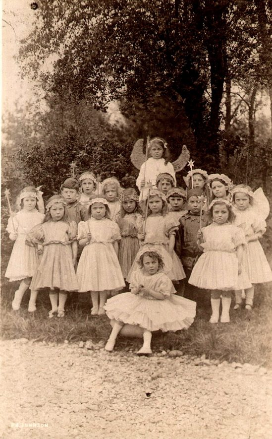 The Fairy Queen with fairies and elves at Studley Council School.  1910s |  IMAGE LOCATION: (Warwickshire County Record Office)