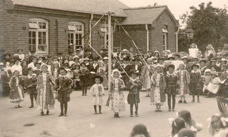 Infants at Studley Council School in costume by May pole on Empire Day.  1920s    IMAGE LOCATION: (Warwickshire County Record Office)