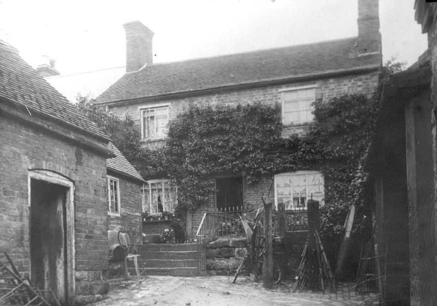 The Old Forge, High Street, Cubbington, showing horse break stocks in which fractious horses were placed before being shod.  1900s |  IMAGE LOCATION: (Warwickshire County Record Office)