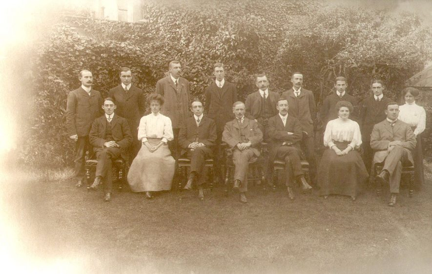 Warwickshire Education Staff.  Back row from left to right:  P. Walters, L.P. Lapworth, W.G. Dickens, R.J. Stubbings, Major Reger, G.H. Paynting, E.V. Humphreys, P.J. Lees, Miss A.V. Colbourne.  Front row from left to right:  H.E. Briscoe, Miss D. Hills, Clement Bone,  Bolton King, Capt, R.T. Hills, Miss E.M. Turner, P. Wasson.  1908 |  IMAGE LOCATION: (Warwickshire County Record Office) PEOPLE IN PHOTO: Wesson, P, Wesson as a surname, Walters, P, Walters as a surname, Turner as a surname, Turner, Miss E N, Stubbings, R J, Stubbings as a surname, Reger, Major, Reger as a surname, Paynting, G H, Paynting as a surname, Lees, P J, Lees as a surname, Lapworth, L P, Lapworth as a surname, King as a surname, King, Mr Bolton, Hunphreys, E V, Humphreys/Humphries as a surname, Hills as a surname, Hills, Miss D, Hills, Capt R T, Dickens, W G, Dickens as a surnme, Colbourne as a surname, Colbourne, Miss A V, Briscoe as a surname, Briscoe, H E, Bone Mr Clement, Bone as a surname
