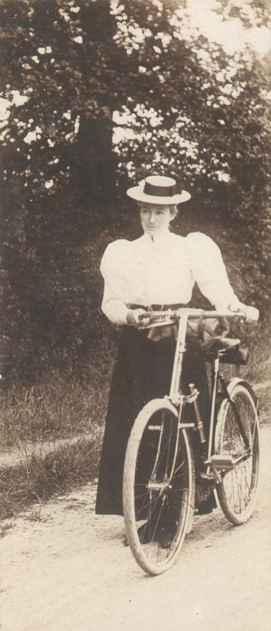 Sarah Beatrice Lowe with her bicycle in Ettington.  c.1895 |  IMAGE LOCATION: (Warwickshire County Record Office) IMAGE DATE: (c.1895) PEOPLE IN PHOTO: Lowe, Sarah Beatrice, Lowe as a surname