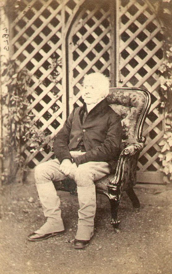Jeffrey Bevington Lowe, as an old man, seated in front of his summer house door at Ettington.  He died 25th October, 1864.  1860 |  IMAGE LOCATION: (Warwickshire County Record Office) PEOPLE IN PHOTO: Lowe, Jeffrey B, Lowe as a surname