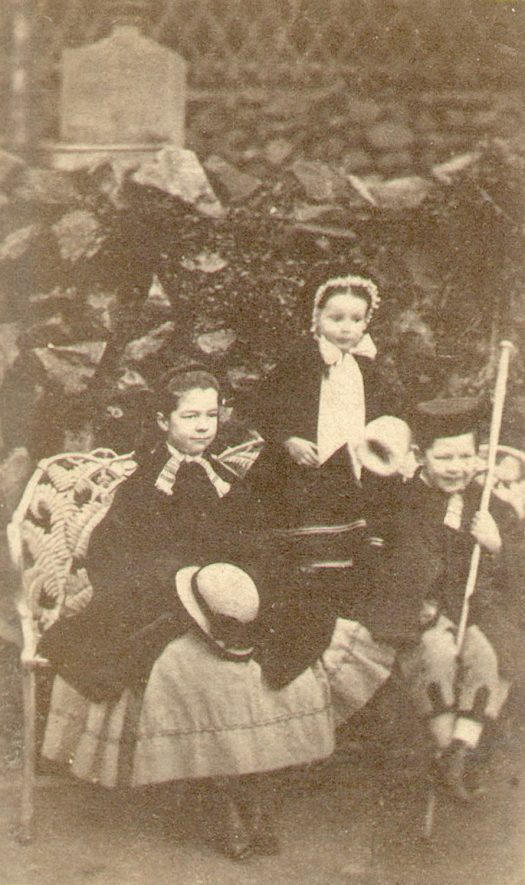 Hubert, Mary and Beatrice Lowe, children of William Bevington Lowe, dressed up.  Ettington.  1867 |  IMAGE LOCATION: (Warwickshire County Record Office) PEOPLE IN PHOTO: Lowe, Mary, Lowe, Hubert, Lowe, Beatrice, Lowe as a surname