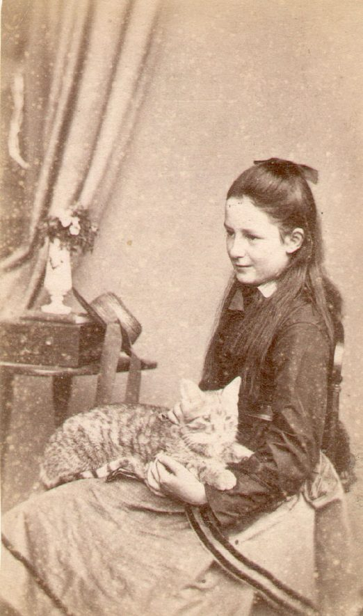 Sarah Beatrice Lowe, age 9, with a cat.  Ettington.  1873 |  IMAGE LOCATION: (Warwickshire County Record Office) PEOPLE IN PHOTO: Lowe, Sarah Beatrice, Lowe as a surname