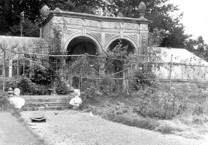 Ettington Park Hotel.  Part of the garden, showing stone summerhouse.  1973 |  IMAGE LOCATION: (Warwickshire County Record Office)