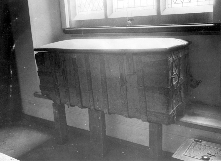 Old dug out chest in the organ room of St Helen's church, Clifford Chambers. In this chest in 1895 were found four deeds dated 1189, 1332, 1350 and 1528. The oldest may date the chest.  1890s |  IMAGE LOCATION: (Warwickshire County Record Office)