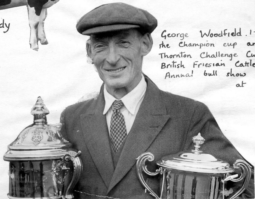 Mr George Woodfield of Clifford Chambers, with the Champion Cup and the Thornton Challenge Cup at the British Friesian Cattle Society Show in 1951. |  IMAGE LOCATION: (Warwickshire County Record Office) PEOPLE IN PHOTO: Woodfield, George, Woodfield as a surname