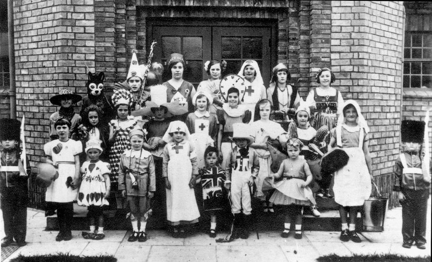 Children in fancy dress outside the village hall, Clifford Chambers, when the Jubilee hall was opened in 1937.