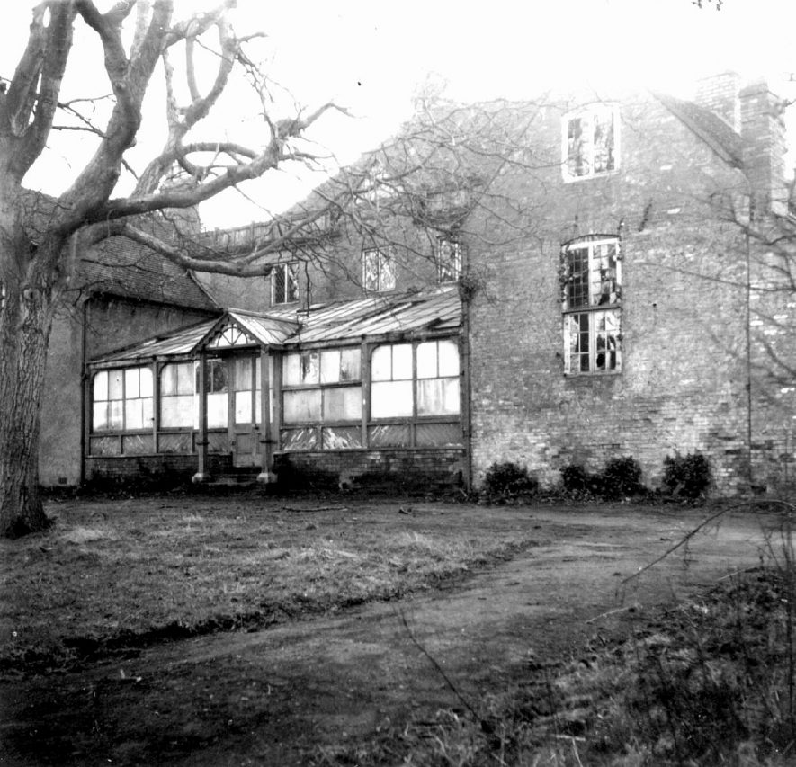 Back of Clifford Lodge, Clifford Chambers. The photograph shows the palm-court and kitchen wing, both which have now been demolished. The lodge deteriorated during the war years, when it was used to accommodate three large families of evacuees, followed by The Pioneer Corps. Later the Women's Land Army came and in 1944 it became a hostel for boys learning farming. The Lodge was eventually sold in the 1950s and renovated.  1940s |  IMAGE LOCATION: (Warwickshire County Record Office)