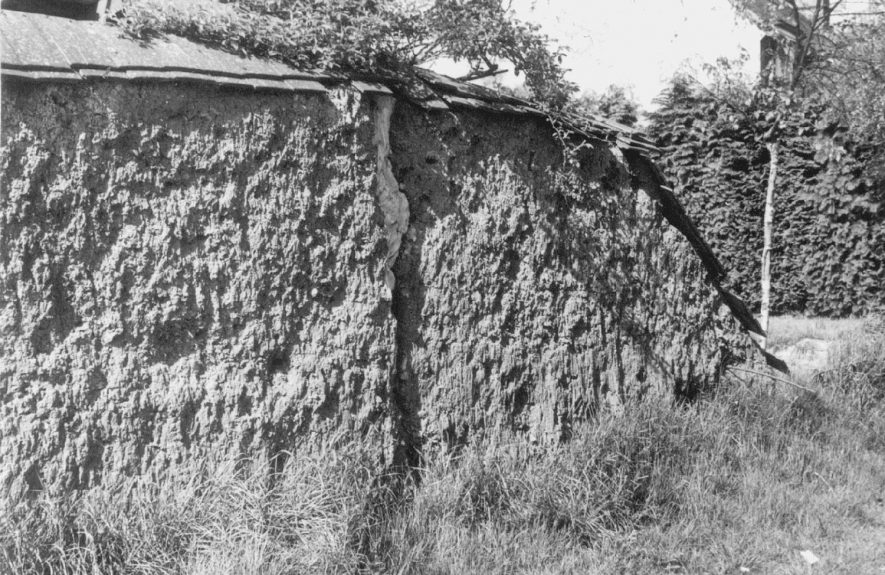 The old clay wall, cob, Clifford Chambers in 1967. This wall collapsed in the winter of 1992/3 and its restoration at that time was uncertain. |  IMAGE LOCATION: (Warwickshire County Record Office)