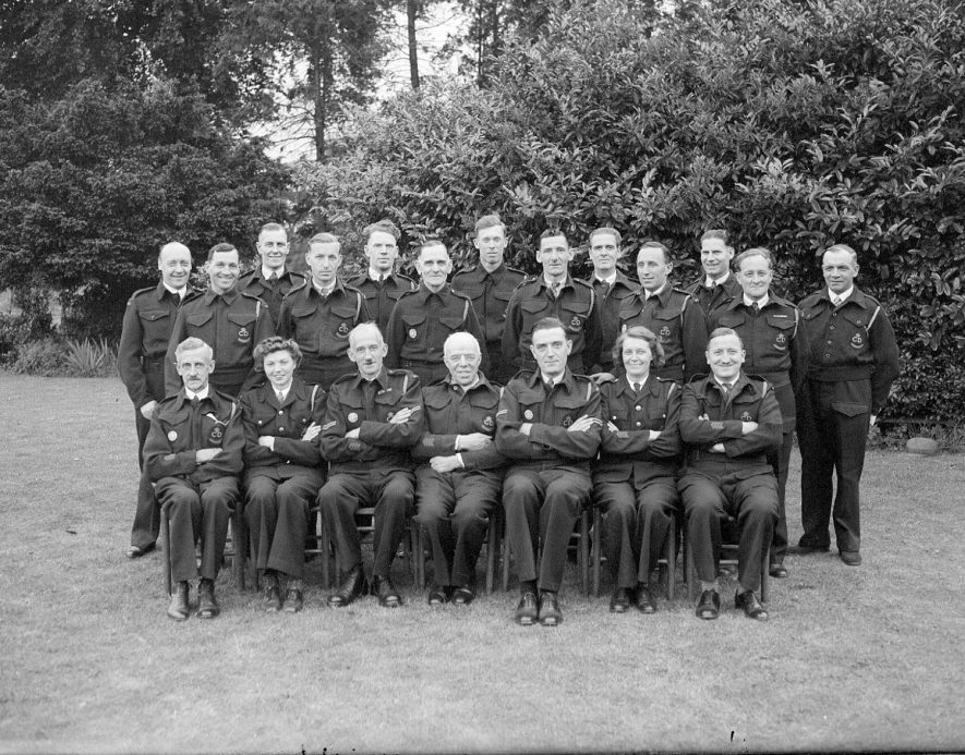 Cubbington air raid wardens. The Reverend Broadway is seen in the centre of the front row and Robert Willifer Stow on the left of the front row.  Photographed 28th May 1945.