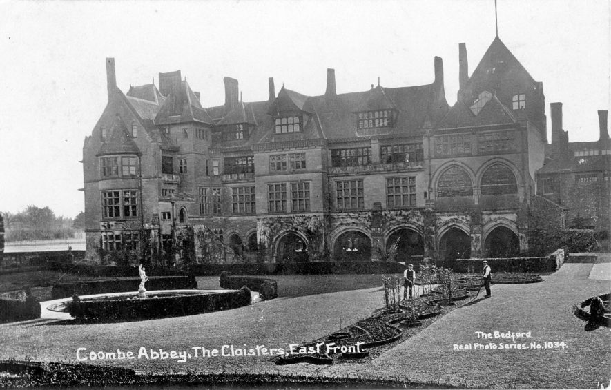 View of exterior of Coombe Abbey showing part of gardens and ornamental pool. Gardeners working.  1920s |  IMAGE LOCATION: (Warwickshire County Record Office)