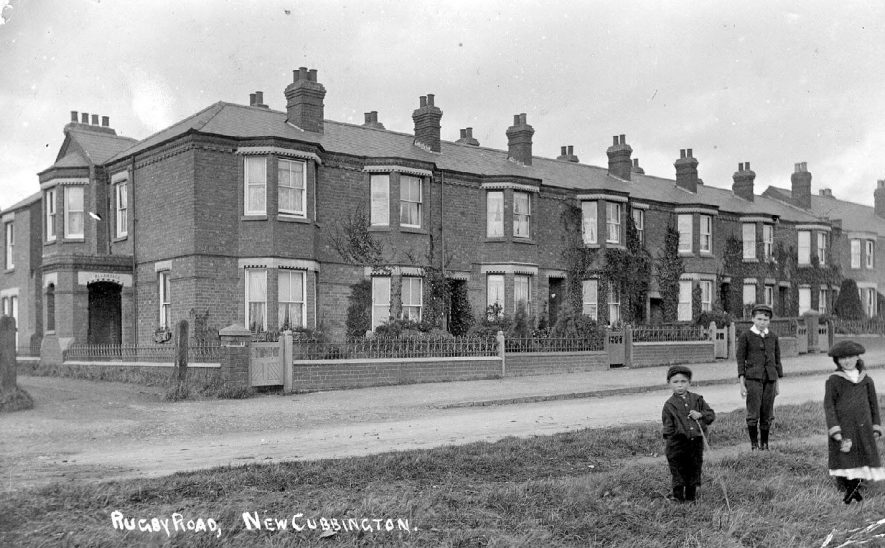 New Cubbington.  Rugby Road.  Terraced houses and three children beside road.  1900s |  IMAGE LOCATION: (Warwickshire County Record Office)