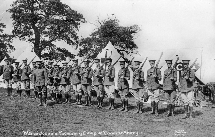 Warwickshire Yeomanry camp with soldiers drilling, Coombe Abbey.  1910s |  IMAGE LOCATION: (Warwickshire County Record Office)